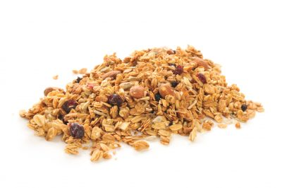 A mound of fresh organic granola on a white background